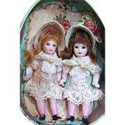 "Two Tiny Vintage 2 1/2"" All Bisque Baby sister dollhouse dolls in Tin egg"