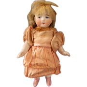 "SALE All Bisque 4-1/2"" Doll with Sweet Face and Beautiful Peach Dress"