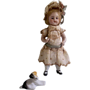 Enchanting Dollhouse size All Bisque German Doll in Wonderful Dress