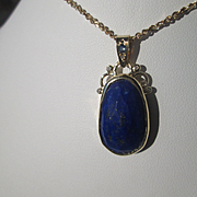 18kt  Yellow Gold Multi Faceted Oval Lapis Lazuli Pendant with Sapphire and Diamonds
