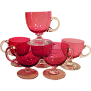 Five  Cranberry Footed Cups with Crystal Handles