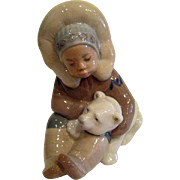 Lladro Eskimo boy and Polar Bear Cub Porcelain Figurine