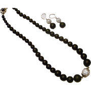 Matte black onyx necklace and earring set with 0.925 sterling silver and pave crystal accents