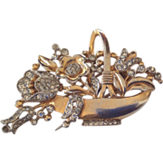 TRIFARI gold plated rhinestones flower basket pin