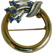 Gold Tone and Silver Tone Circle Pin with Blue Rhinestones, 1960's