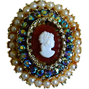 Lovely Oval Brooch with Faux Cameo Surrounded by Aurora Borealis Rhinestones and Faux Pearls M