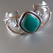 Signed Navajo Sandcast Sterling Turquoise Bracelet