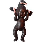 Black bisque Japan baby, with hair tufts