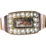 Georgian 9kt mourning ring set with seed pearls and hairwork