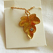 SALE Classy Sleek Avon's Best Gold Plated Grape Leaf w Accent Stone Pendant