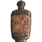 19 th century Chinese snuff bottle with carved bone detail , turquoise and coral stones.