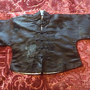 Child's Chinese mandarin silk jacket in perfect unworn condition . Early 20 th century.