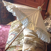 19 th century very pretty parasol in pale eau de nil and cream glazed cotton,