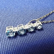 9ct White Gold & Aquamarine Pendant On Sterling Silver Chain