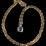 9ct White Gold Topaz & Diamond Pendant With 9ct Yellow Gold Chain