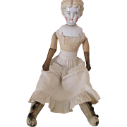 Antique Blond China Head Doll with Serene Expression