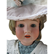"""Antique Bisque Head Doll Marked """"Special 65"""""""