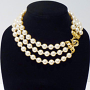 Classic Three-Strand Faux Pearl Necklace in Warm Cream with Elegant Clasp