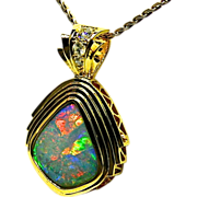 Ladies 18K Yellow Gold Pendant featuring 9.35 Carat Solid Australian Opal with Diamond Accents