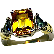 Ladies Platinum Ring with a 4.50 Carat Yellow Sapphire and Blue Sapphire Accents