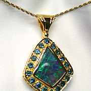 Ladies Lightning Ridge Solid Opal 18K Yellow Gold Pendant with Enhanced Blue Diamonds