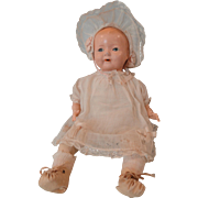 Cute Flirty Eyed Composition Baby by Ideal