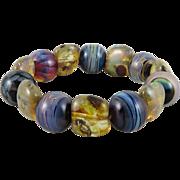 SOLD Glowing Art Glass Bead Bracelet