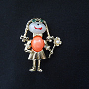 Jelly Belly Girl with pig tails and flower pin brooch