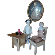 Frozen Charlotte with Parian Doll and Table and Chair