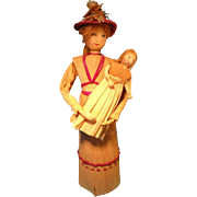 Corn Husk Doll Holding Baby by May Deschamps