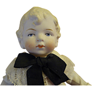 "All Bisque Boy with Wonderful Blonde Molded Hair and Costume 7 1/2"" Tall"