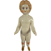 """4"""" Frozen Charlotte with Gold Slippers and Red Garters"""