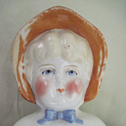 REDUCED 1890's German China Shoulder head Doll with Molded Bonnet.