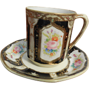 Nippon Demitasse Floral Pattern  Cup and Saucer edged with gold gilt