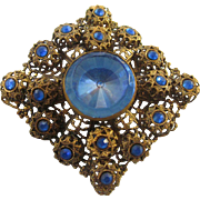 Ornate Czech Glass Brooch With Vibrant Sapphire Blue Rhinestones and Glass Cabochon