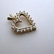 Diamond and 14K gold heart pendant