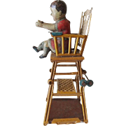 SALE PENDING Old Toy Tin Child in Folding High Chair