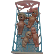 Thomas Toy Cradle 1940's Plastic w/4 miniature Celluloid Kewpies