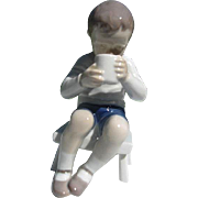 "B & G Porcelain Figurine of Boy on Bench Drinking from Mug - Title ""Victor - Made in ..."