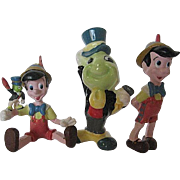 Disney Two Hard Rubber Pinocchio and one Porcelain Jiminy Cricket figurine
