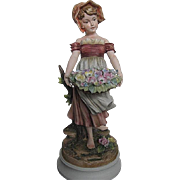Exquisite Sadek Bisque figurine of Country Girl carrying a Large basket of Flowers - 7735 by A