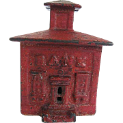 "Early 1900's Red Cast Iron Still Bank - J. E. Stevens - ""Small Cupola Building Bank"""