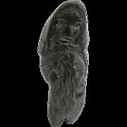 SOLD Intuit art Carving of Eskimo holding Seal - Canada Eskimo Art