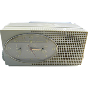 SOLD Vintage Golden Shield Tube Clock Radio by Sylvania - 50's era