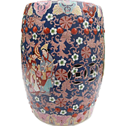Hand-painted Chinese Cobalt Blue & Orange Garden stool displaying Persons Playing Instruments