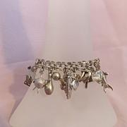 Loaded Sterling Vintage Charm Bracelet