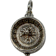 Roulette silver charm with a gun underneath
