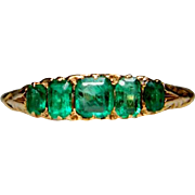 Emerald five stone carved half hoop ring