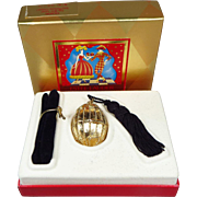 SOLD Estee Lauder Knowing Solid Perfume Gold Egg with Tassel Compact