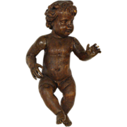 Wood carved cherub